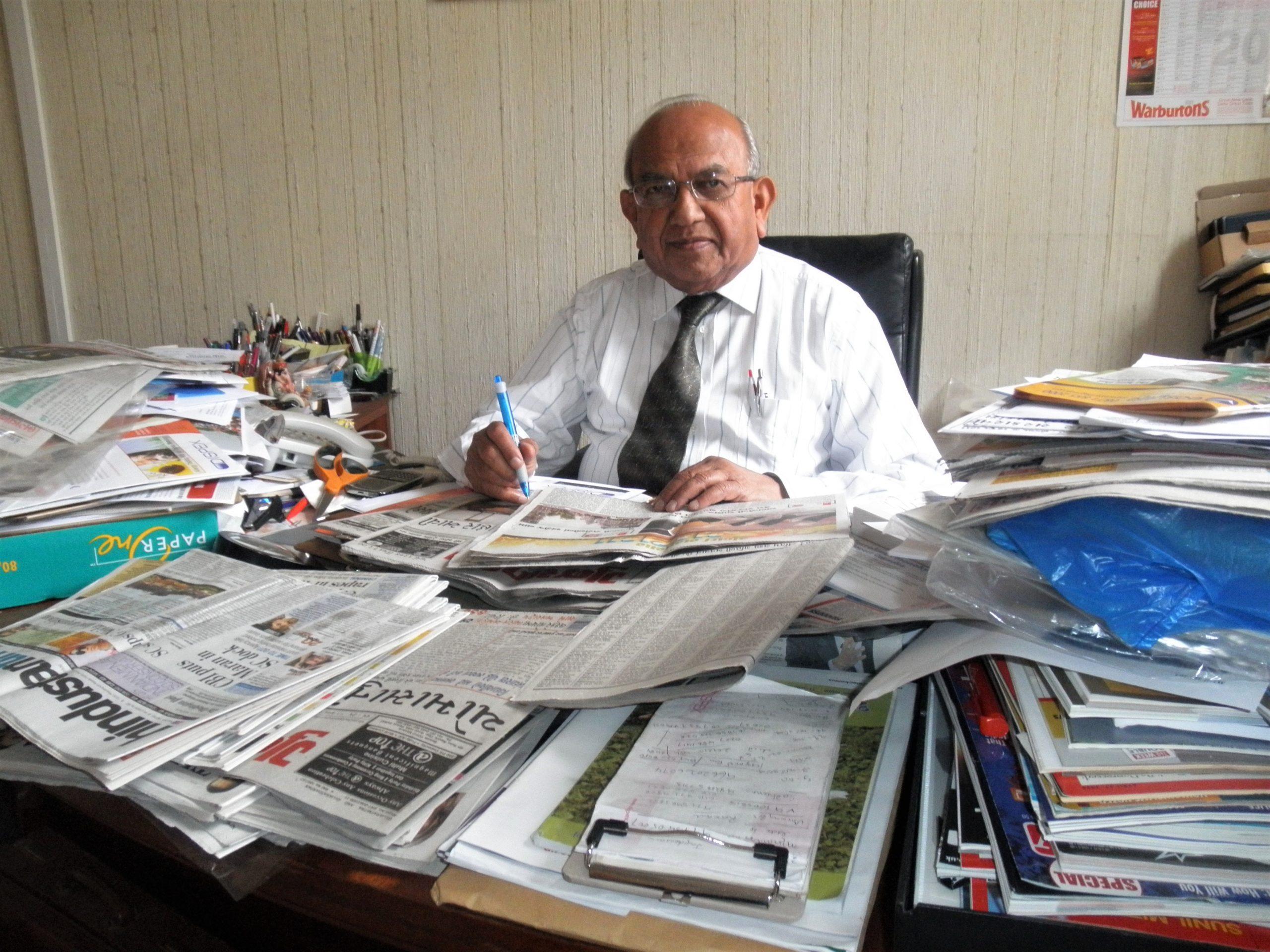 Ramniklal Solanki at his desk at AMG offices.