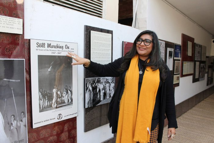 In this picture, human rights award winner and founder of Pakistan's first cyber-harassment helpline, Nighat Dad, looks at a picture gallery at the ASR Resource Centre in Lahore. (AFP)
