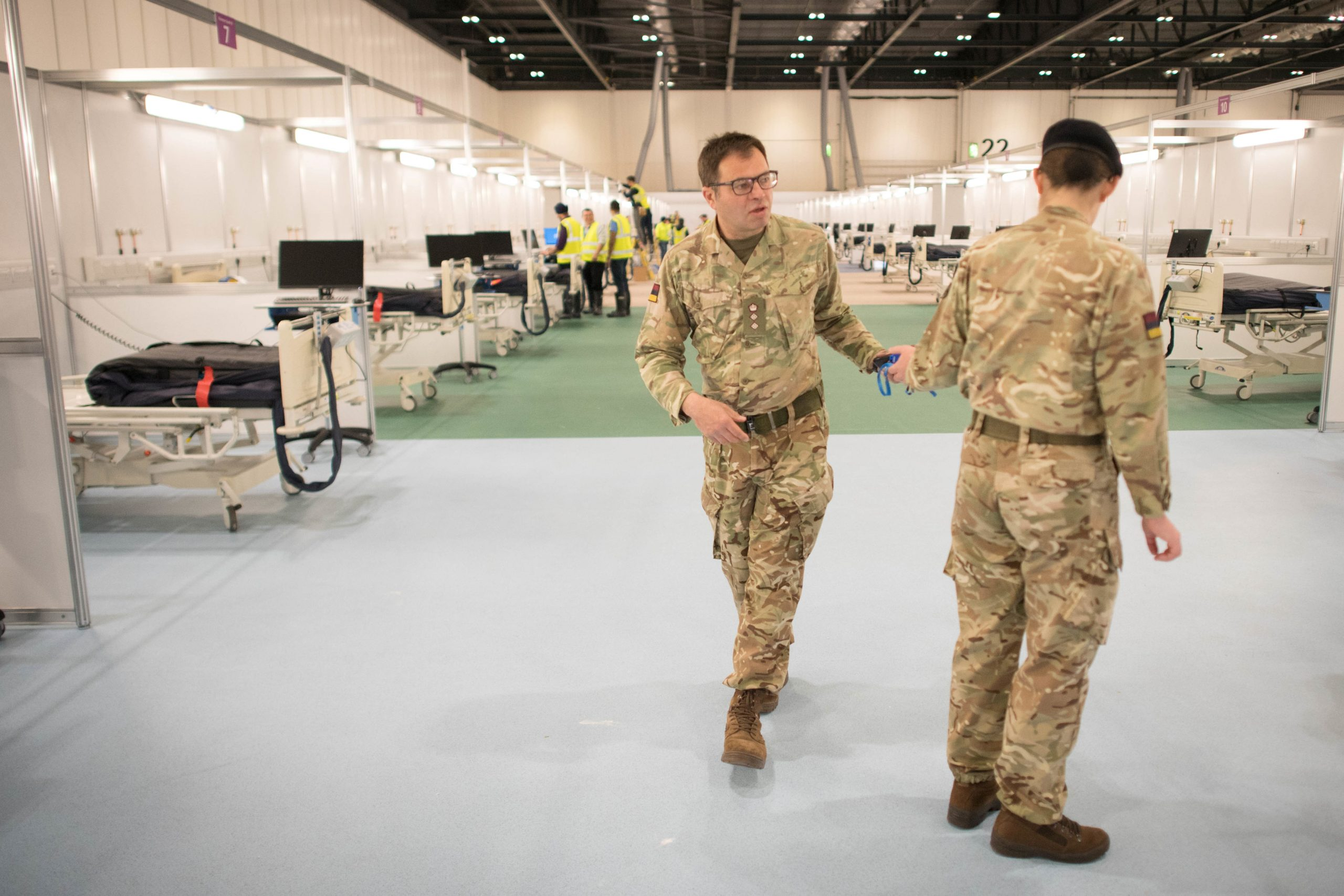 Military personnel is seen at ExCel London, during its conversion into the temporary NHS Nightingale Hospital, comprising of two wards, each of 2,000 people, to help tackle the coronavirus disease (Covid-19) outbreak, in London, Britain on March 31, 2020. As on date, the UK registered over 25,000 Covid-19 cases and 1,829 deaths. (Photo: Stefan Rousseau/Pool via REUTERS)