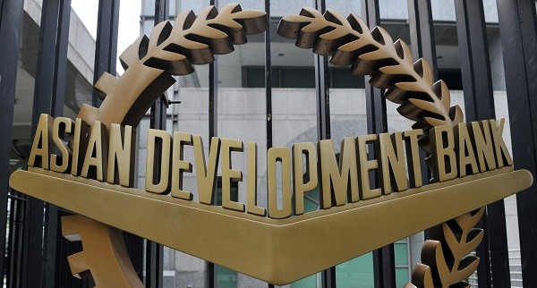 FILE PHOTO: A picture shows the logo of the Asian Development Bank (ADB) displayed outside its headquarters in Manila (TED ALJIBE/AFP/Getty Images)