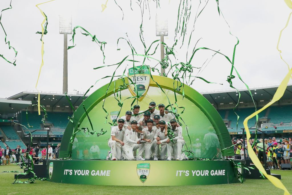 FILE PHOTO: The Australian team poses with the Trans-Tasman Trophy after winning the series on the fourth day of the third cricket Test match between Australia and New Zealand at the Sydney Cricket Ground in Sydney on January 6, 2020. (Photo by JEREMY NG / AFP)