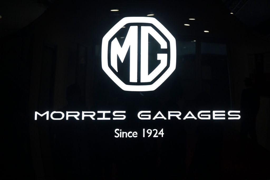 A close-up of the logo of MG Motor at the Auto Expo 2020 at Greater Noida on the outskirts of New Delhi (Photo by MONEY SHARMA/AFP via Getty Images)