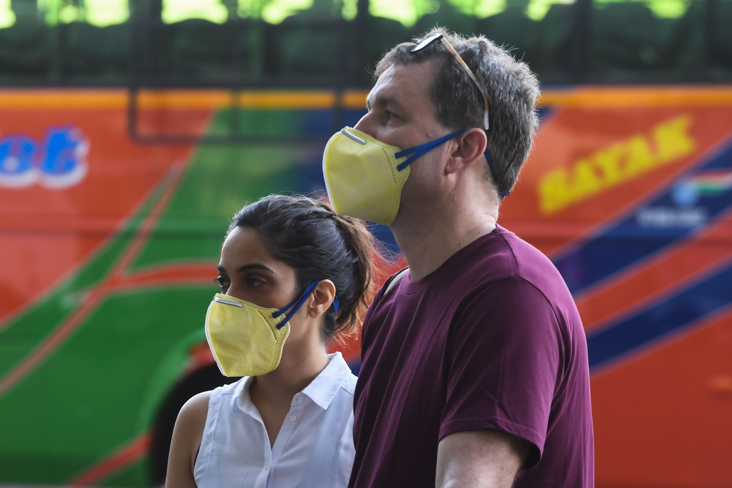 Foreign nationals wearing facemasks line up outside the departure terminal of the Netaji Subhash Chandra Bose International Airport to board a special evacuation flight during a government-imposed nationwide lockdown as a preventive measure against the COVID-19 coronavirus, in Kolkata on March 31, 2020. (Photo by Dibyangshu SARKAR / AFP)