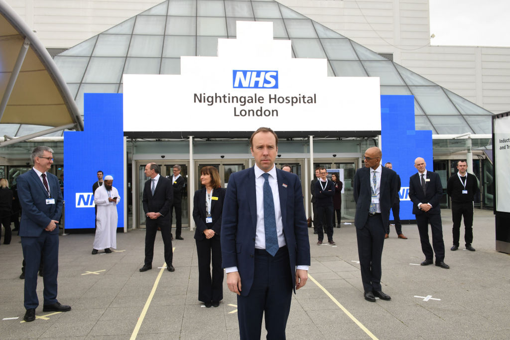 Matt Hancock the UK Secretary of State for Health and Social Care stands on a mark on the ground, put in place to ensure social distancing guidelines are adhered to, at the opening of the NHS Nightingale Hospital at the ExCel centre on April 3, 2020 in London, England. (Photo by Stefan Rousseau - WPA Pool/Getty Images)