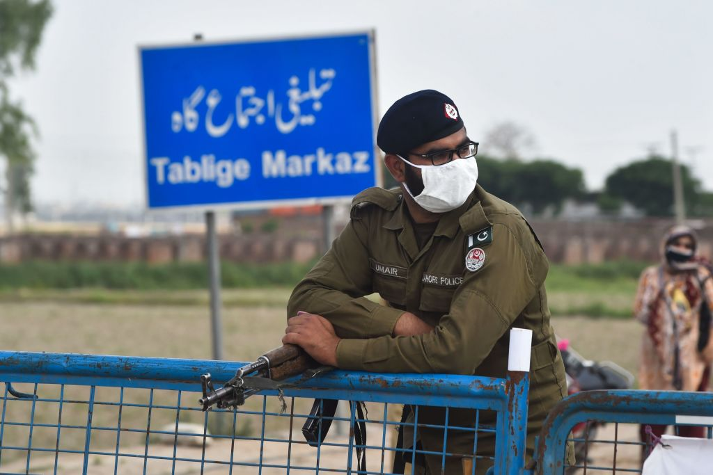 A policeman wearing a facemask stands at the Tablighi Markaz checkpoint during a government-imposed nationwide lockdown as a preventive measure against the COVID-19 coronavirus, in Lahore on April 5, 2020.  (Photo by ARIF ALI/AFP via Getty Images)