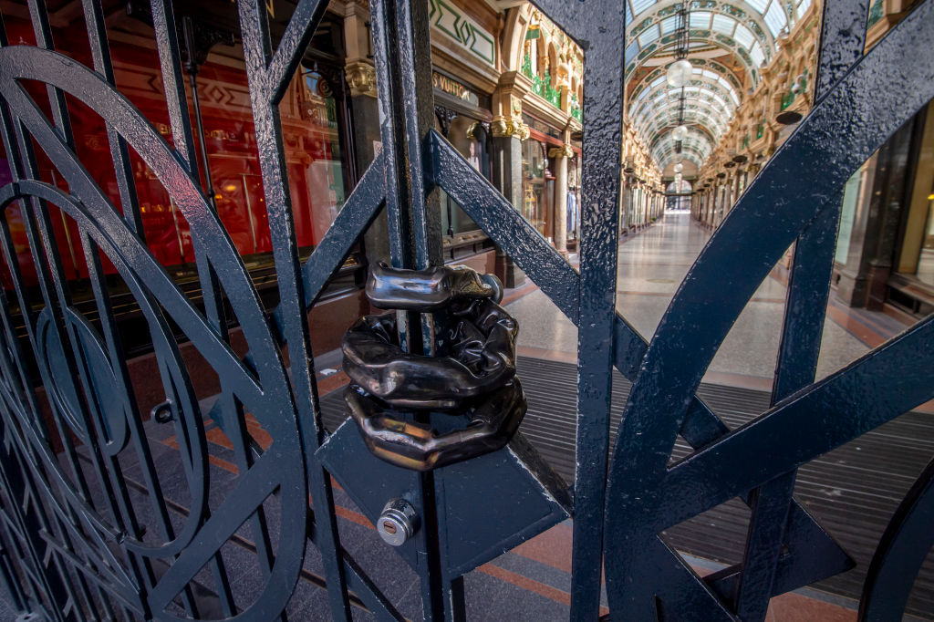 File photo: A chain is seen on the gates of a closed shopping arcade in Leeds city centre, West Yorkshire, as life in Britain continues during the nationwide lockdown to combat the novel coronavirus Covid-19 pandemic. (ANTHONY DEVLIN/AFP via Getty Images)