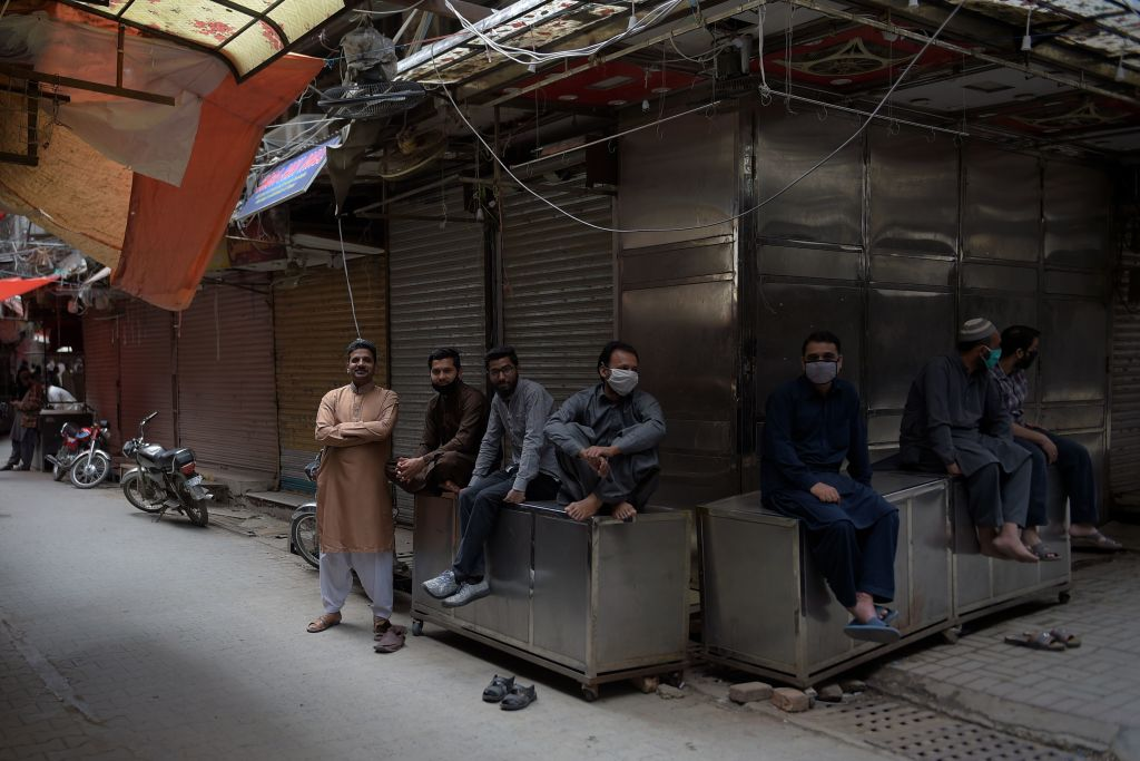 Pakistani shopkeepers gather in front of their closed shops during a government-imposed nationwide lockdown as a preventive measure against the COVID-19 coronavirus, in Rawalpindi on April 15, 2020. (Photo by FAROOQ NAEEM/AFP via Getty Images)