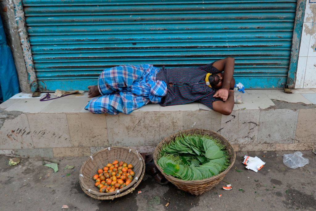 A man sleeps during a government-imposed shut-down as a preventive measure against the COVID-19 coronavirus, in Dhaka on April 20, 2020.(Photo by MUNIR UZ ZAMAN/AFP via Getty Images)