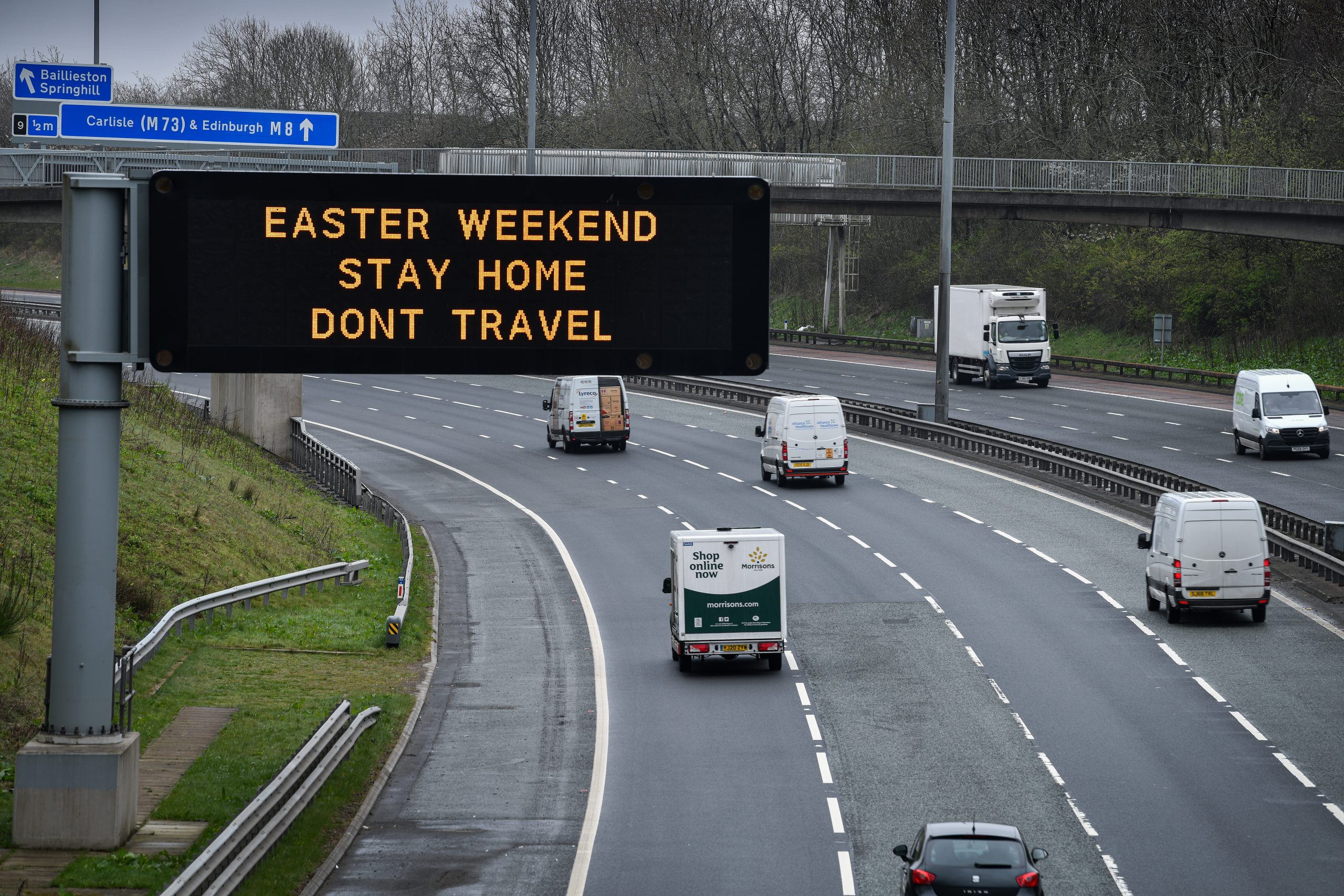 GLASGOW, SCOTLAND - APRIL 09: An overhead sign on the M8 advises people not to travel this Easter Weekend on April 9, 2020 in Glasgow, Scotland. There have been around 60,000 reported cases of the COVID-19 coronavirus in the United Kingdom and 7,000 deaths. The country is in its third week of lockdown measures aimed at slowing the spread of the virus. (Photo by Jeff J Mitchell/Getty Images)