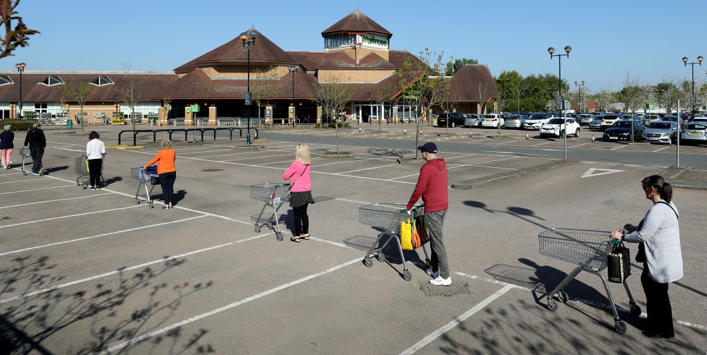 Shoppers queue using safe distance measures at Waitrose supermarket on April 22, 2020 in Rushden.  (Photo: David Rogers/Getty Images)