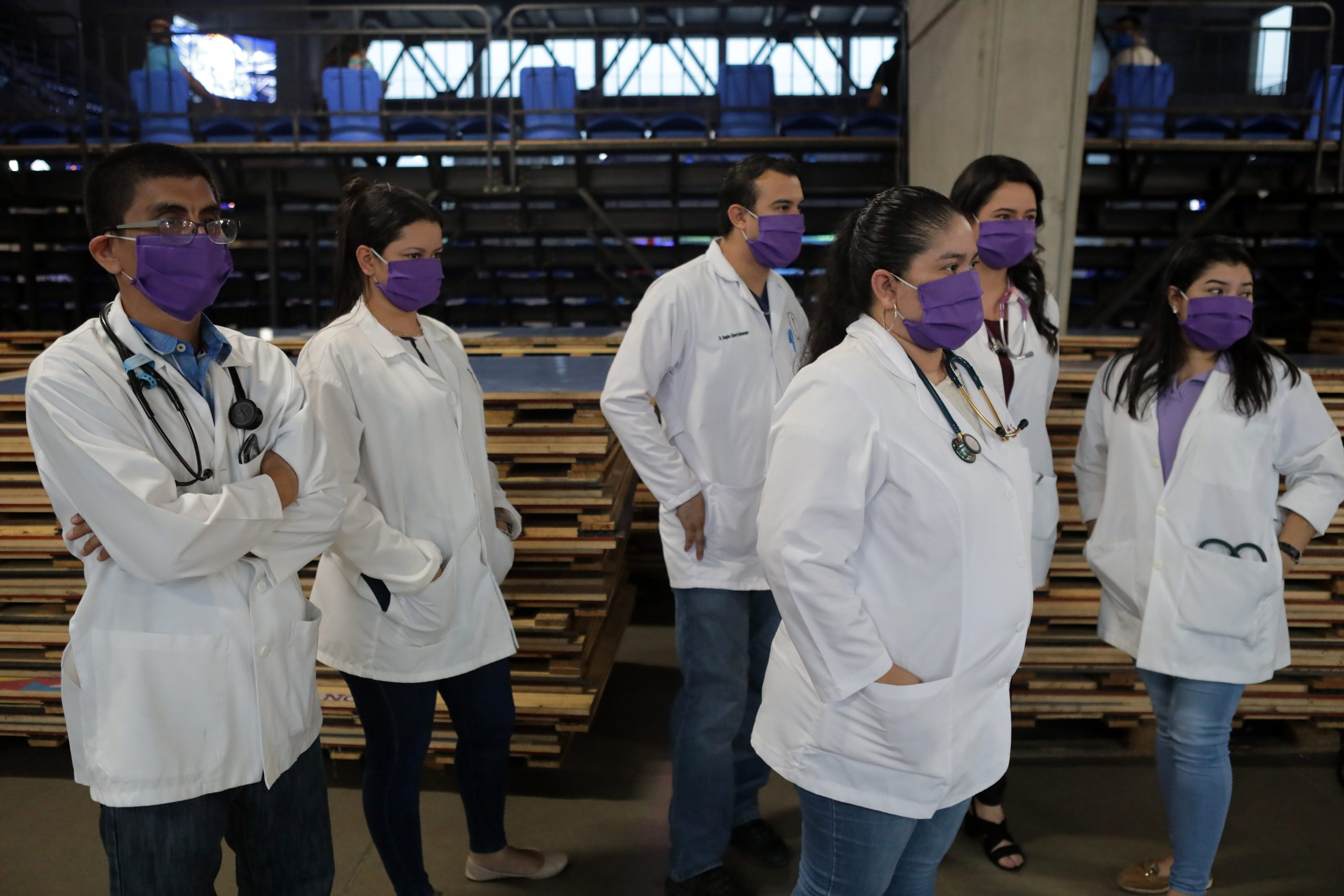 MANAGUA, NICARAGUA - APRIL 25: Doctors stand together wearing face masks at Alexis Arguello Sports Center on April 25, 2020 in Managua, Nicaragua. Nicaragua is one of the very few countries that allow sport events during the COVID-19 pandemic. (Photo by Inti Ocon/Getty Images)
