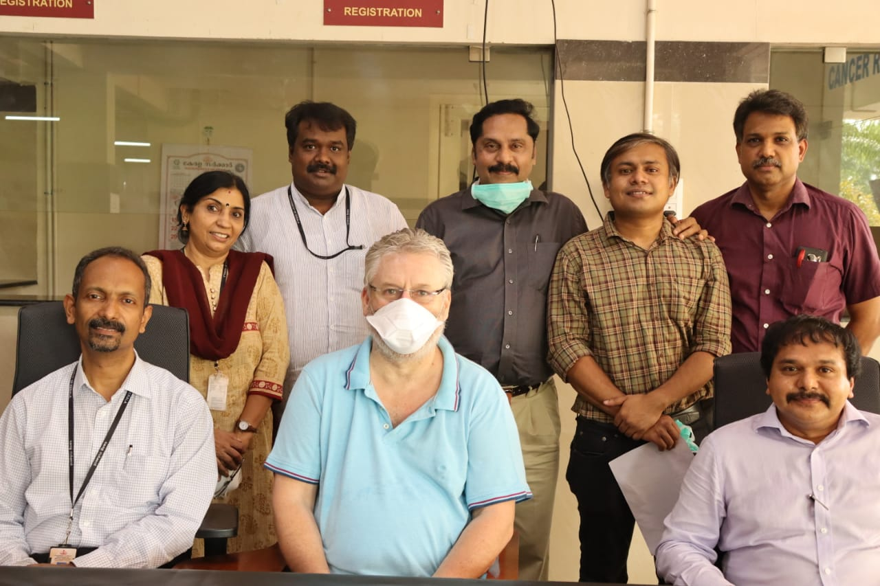 Brian Neil (C) with the staff at Government Medical Collge in Ernakulam, Kerala.