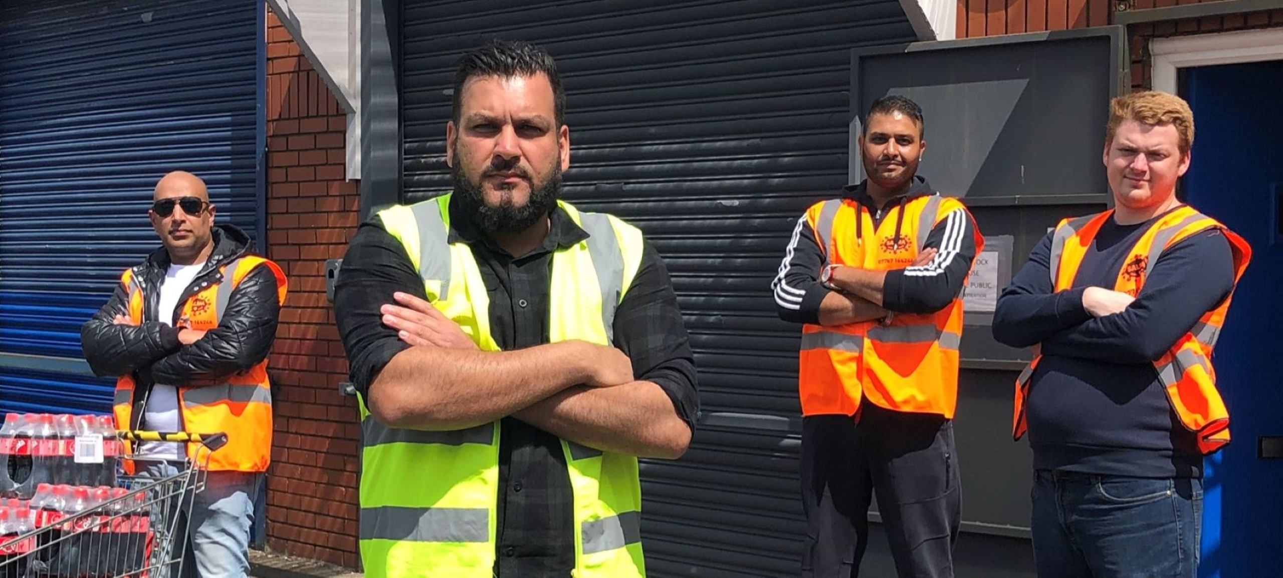 HELPING HANDS: Imran Hameed (second from left) with other Bearded Broz volunteers