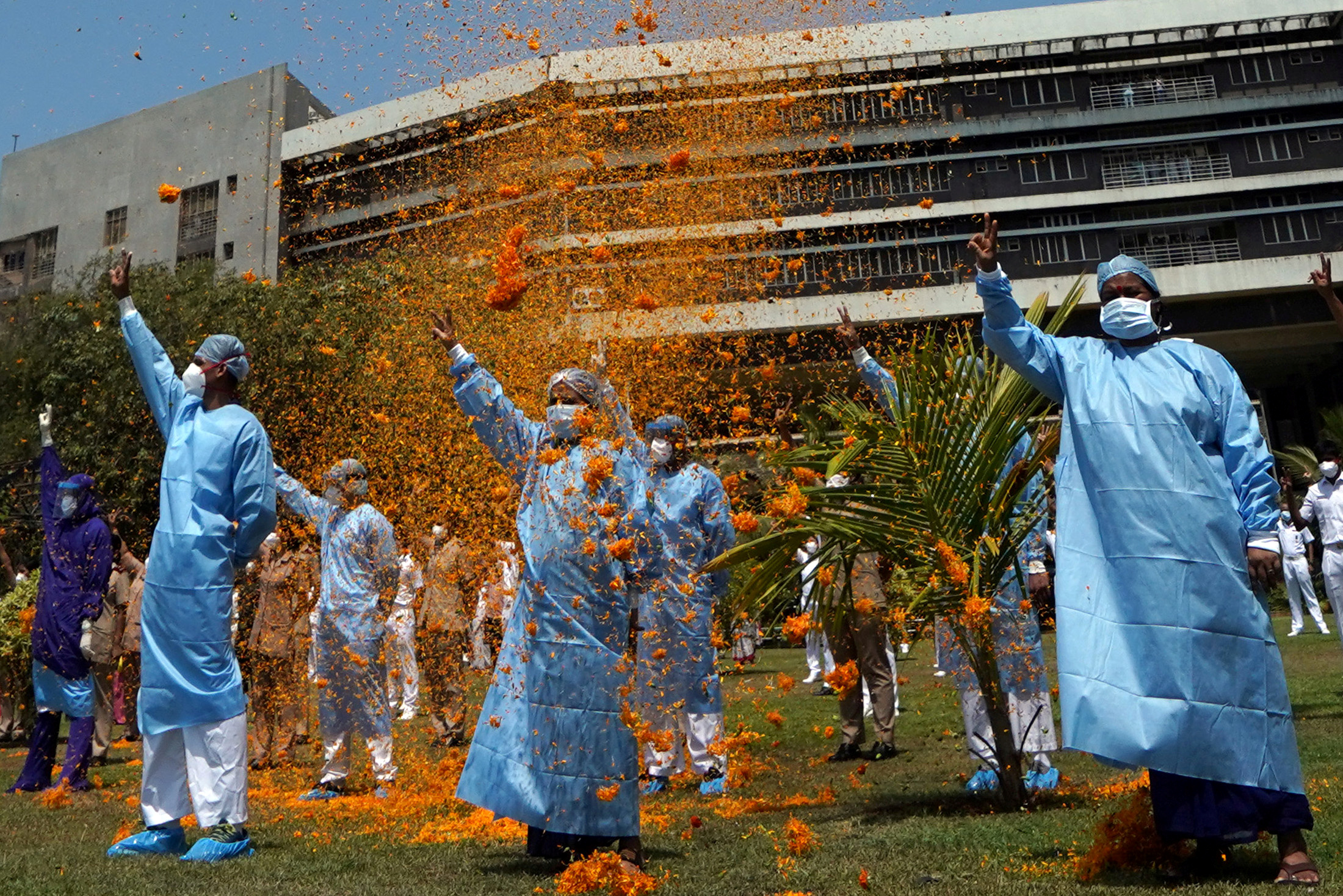 The staff of INHS Asvini hospital are showered with flower petals by Indian Navy's Chetak helicopter as part of an event to show gratitude towards the frontline warriors fighting the coronavirus disease (COVID-19) outbreak, in Mumbai, India, May 3, 2020. REUTERS/Hemanshi Kamani