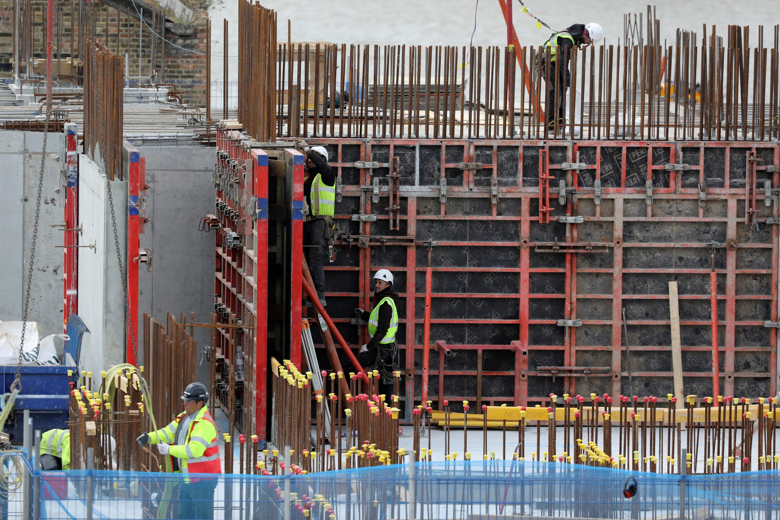 Construction workers  a site in Londonon May 11, 2020. (REUTERS/Simon Dawson)