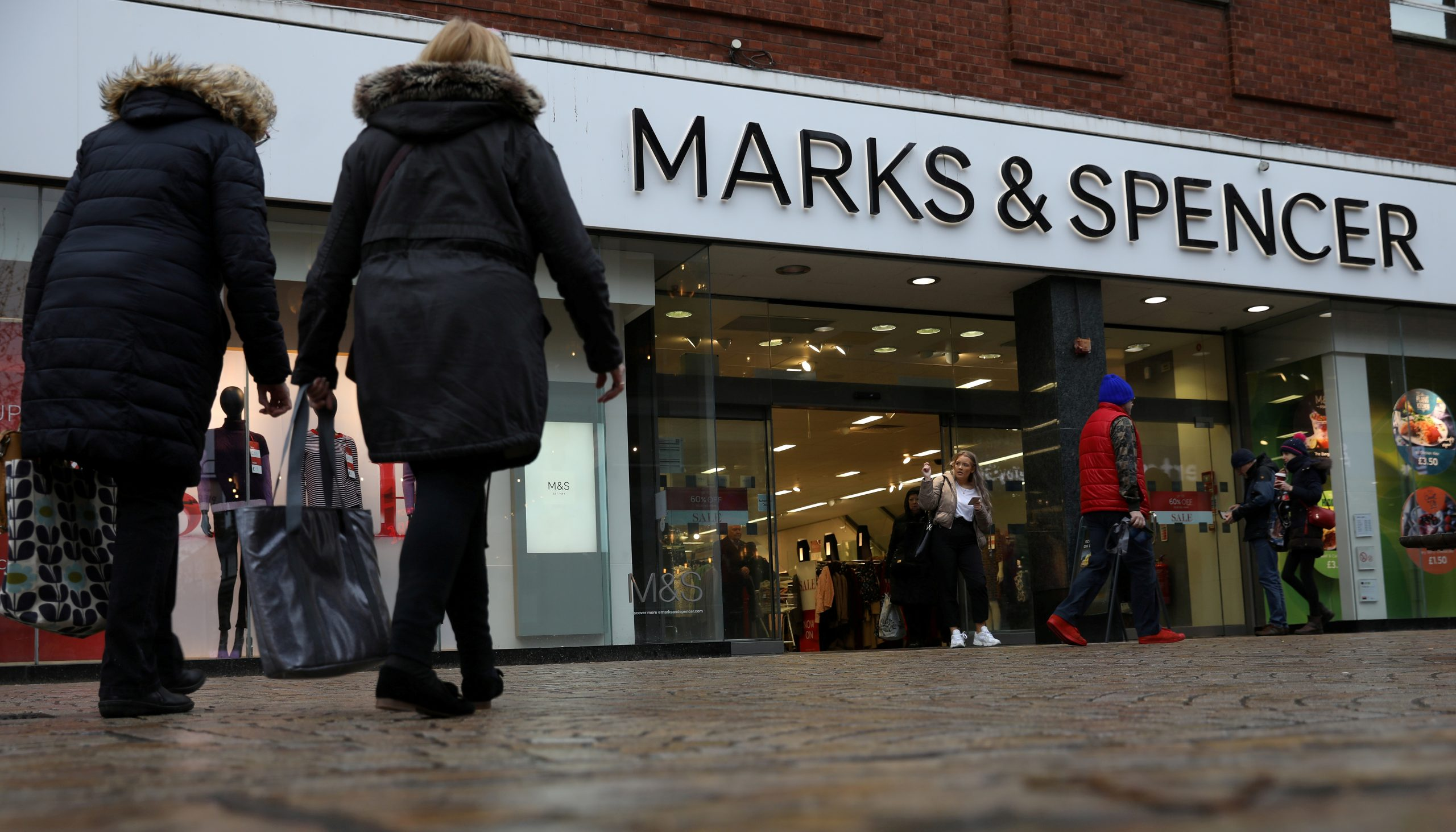 FILE PHOTO: Shoppers walk past a branch of Marks and Spencer in Altrincham on January 7 2020. (REUTERS/Phil Noble)