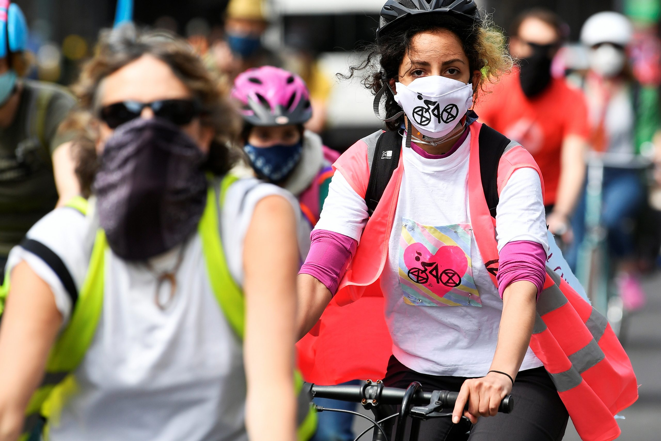 Members of Extinction Rebellion take part in a socially distanced bicycle ride to campaign for more cycling and cycle lanes and fewer vehicles on the roads in London on May 17, 2020. (REUTERS/Toby Melville)