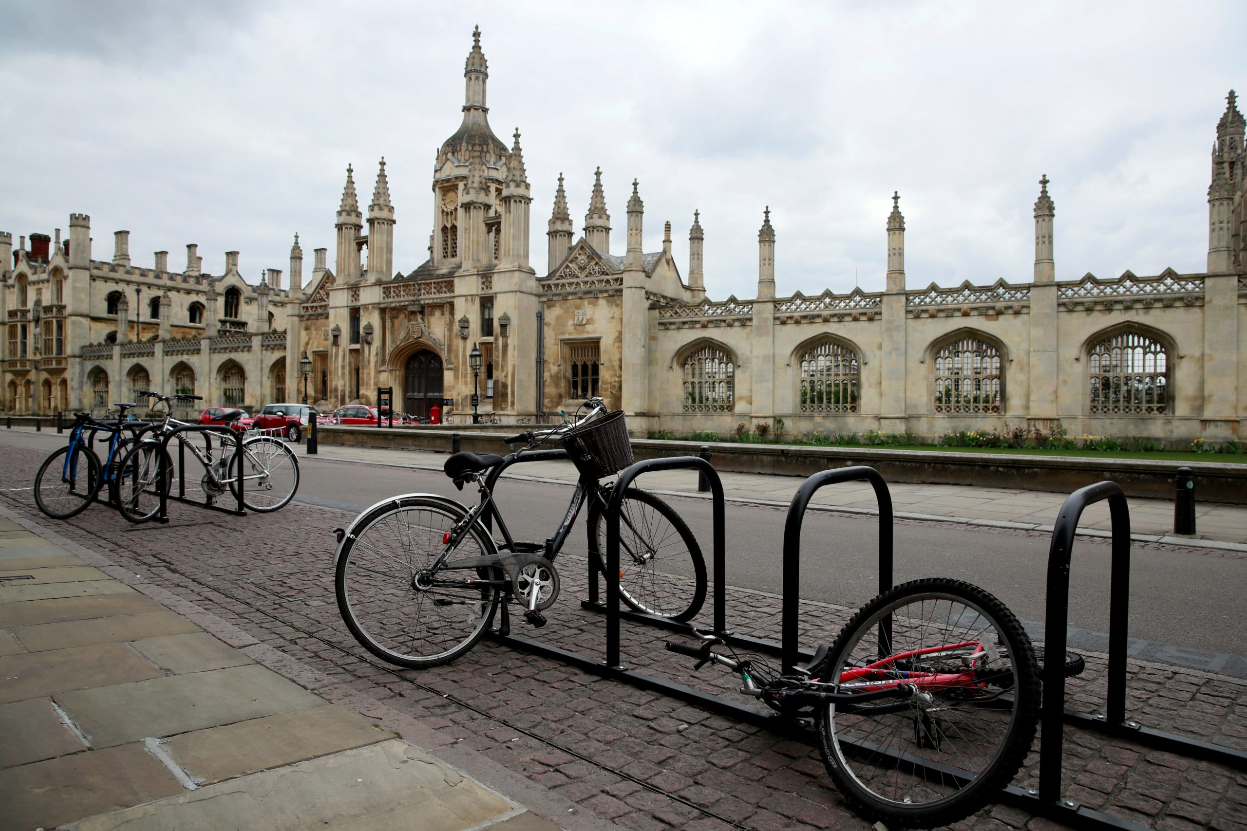 FILE PHOTO: Bikes are seen outside Cambridge University, as the spread of the coronavirus continues, Cambridge, Britain, April 1, 2020. (REUTERS/Andrew Couldridge)