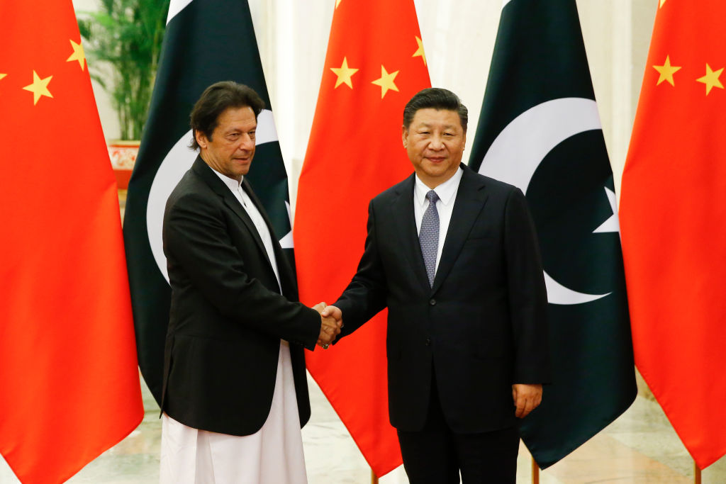 FILE PHOTO: Chinese President Xi Jinping meets Pakistani Prime Minister Imran Khan at the Great Hall of the People in Beijing, China. (Photo by Thomas Peter-Pool/Getty Images)