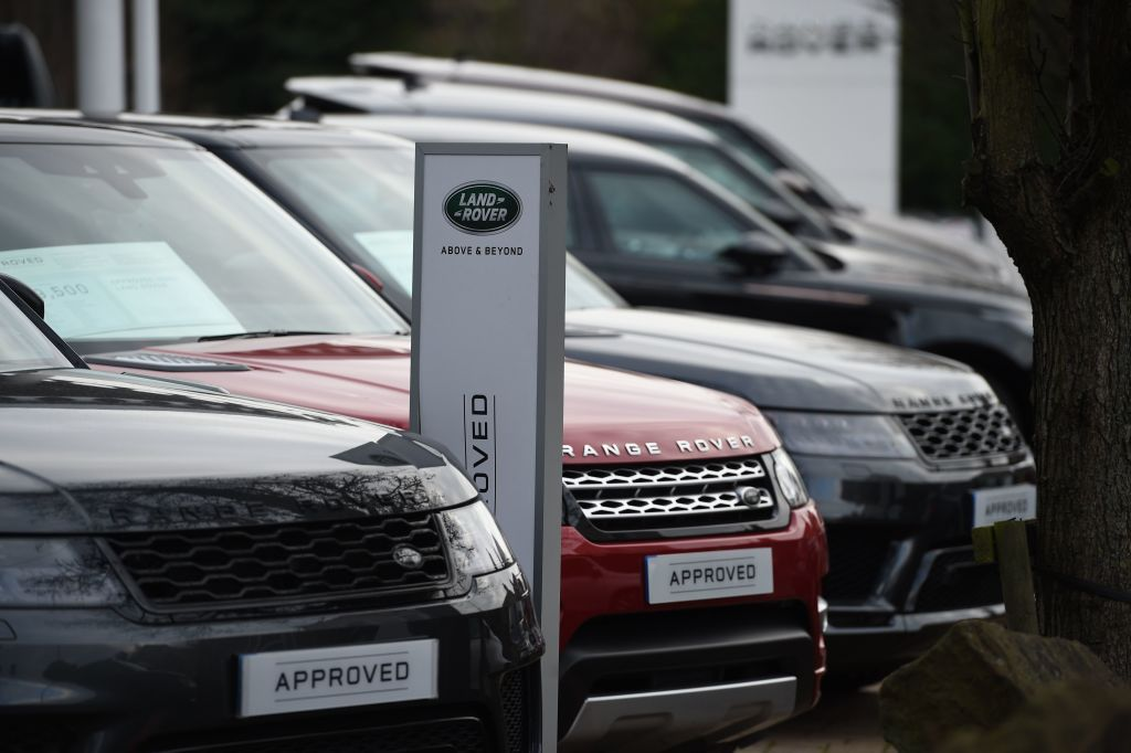 File photo of Range Rover cars at a Land Rover dealership in Wakefield. (OLI SCARFF/AFP via Getty Images)