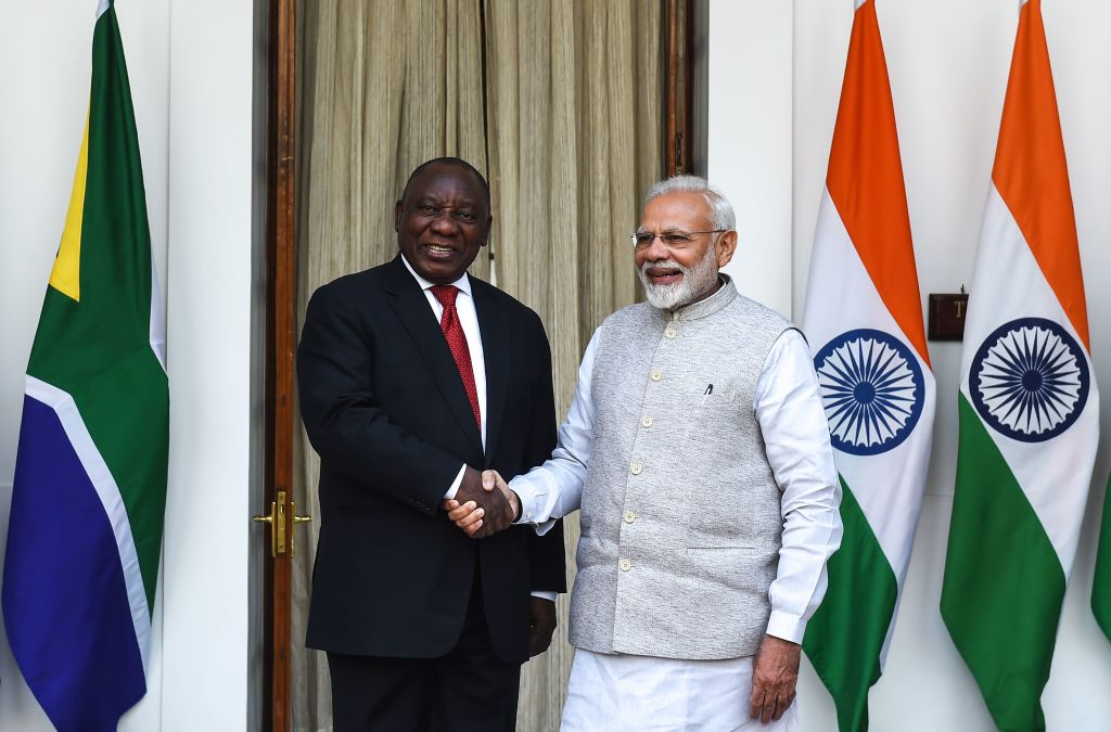 FILE PHOTO: South African President Cyril Ramaphosa (L) shakes hand with Indian Prime Minister Narendra Modi prior to a meeting at Hyderabad House in New Delhi. (Photo by MONEY SHARMA/AFP via Getty Images)