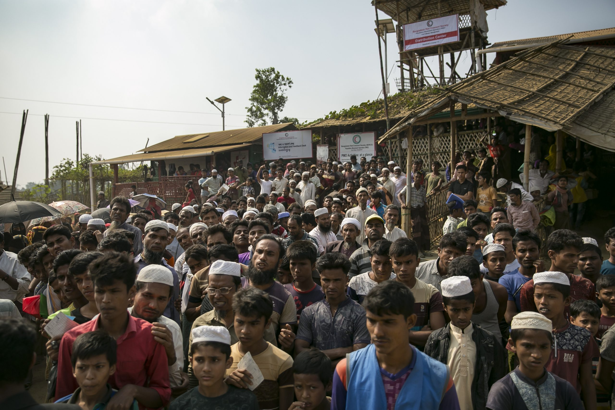 COX'S BAZAR, BANGLADESH - DECEMBER 11: Rohingya refugees queue for a blanket distribution in a refugee camp on December 11, 2019 in Cox's Bazar, Bangladesh. The UN's International Court of Justice in The Hague began on Tuesday hearing a case filed by The Gambia against Myanmar over the Rohingya genocide case. (Photo by Allison Joyce/Getty Images)