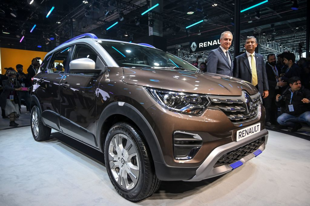 FILE PHOTO: Chairman of AMI-Pacific (Africa, Middle East, India) of Groupe Renault, Fabrice Cambolive (L) poses next to the Renault Triber vehicle displayed at the Auto Expo 2020 at Greater Noida on the outskirts of New Delhi. (Photo by MONEY SHARMA/AFP via Getty Images)