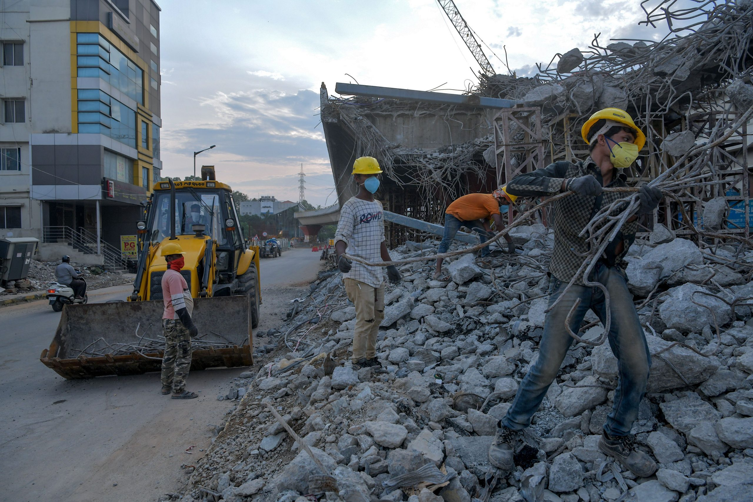 Bengaluru Metropolitan Rail Corporation Limited (BMRCL) labourers go back to work to destroy Jayadeva Circle Flyover for the second construction phase on 'Namma Metro Rail' network, after the government-imposed nationwide lockdown against the COVID-19 coronavirus has been lightened, in Bangalore on April 24, 2020. (Photo by Manjunath Kiran / AFP) (Photo by MANJUNATH KIRAN/AFP via Getty Images)