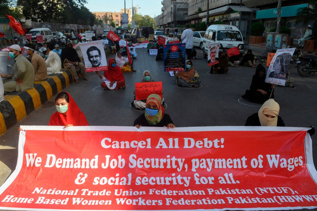 Labour union workers maintain social distancing as they carry placards during a May Day rally in Karachi on May 1, 2020. (Photo by ASIF HASSAN/AFP via Getty Images)