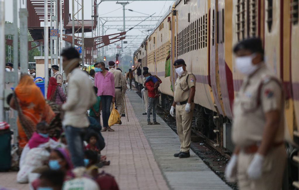 Migrant workers deboard from a special train that arrived from Nasik during a government-imposed nationwide lockdown as a preventive measure against the COVID-19 coronavirus, at Misrod railway station in Bhopal on May 02, 2020. (Photo by GAGAN NAYAR/AFP via Getty Images)