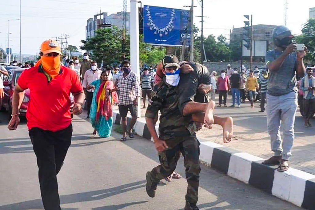 Rescuers evacuate people following a gas leak incident at an LG Polymers plant in Visakhapatnam on May 7, 2020. - At least five people have been killed and several hundred hospitalised after a gas leak at a chemicals plant on the east coast of India, police said on May 7. They said that the gas had leaked out of two 5,000-tonne tanks that had been unattended due to India's coronavirus lockdown in place since late March. (Photo by -/AFP via Getty Images)