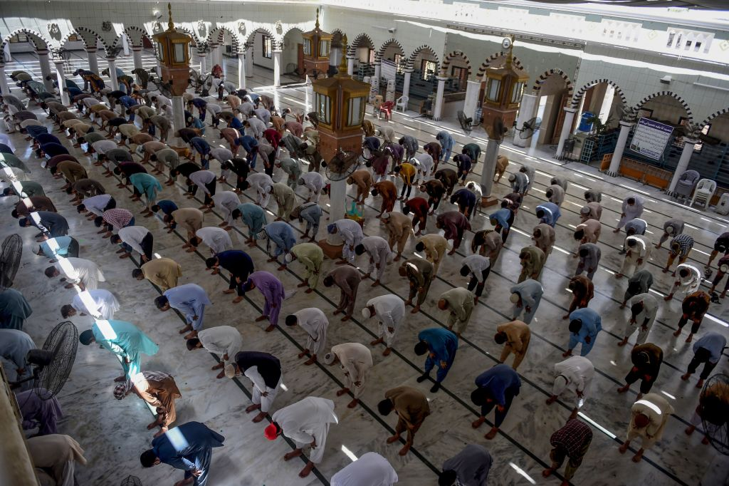 Muslim devotees offer Friday prayers at a mosque during the Islamic holy month of Ramadan in Karachi on May 8, 2020. (Photo by RIZWAN TABASSUM/AFP via Getty Images)