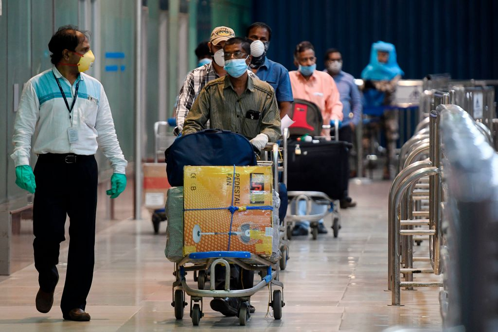 Indian citizens evacuated from Dubai by Air India flight, arrive at the Anna International Airport as part of a massive repatriation effort due to the COVID-19 coronavirus pandemic, in Chennai on May 9, 2020. (Photo by ARUN SANKAR/AFP via Getty Images)