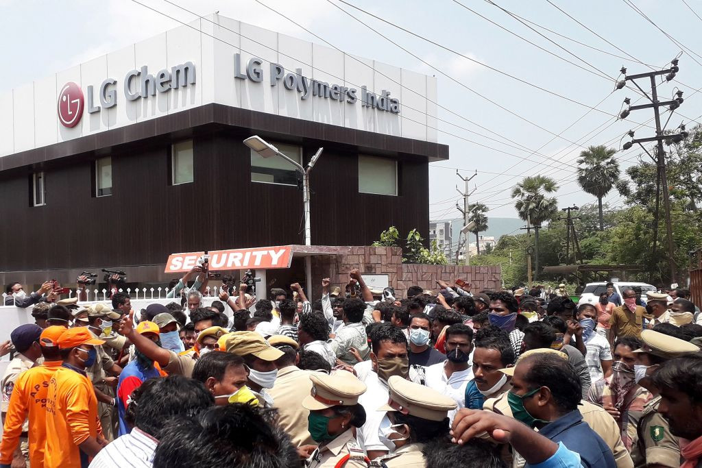 Residents protest in front of LG Polymers plant demanding justice to the gas leak victims, in Visakhapatnam, in Andhra Pradesh state (Photo by STR/AFP via Getty Images)
