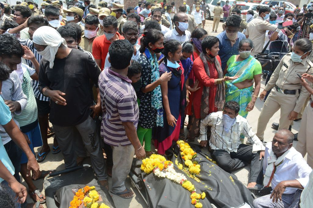 Residents gather with the bodies of the victims of a gas leak incident as they protest in front of an LG Polymers plant in Visakhapatnam, in Andhra Pradesh state on May 9, 2020. (Photo by STR/AFP via Getty Images)