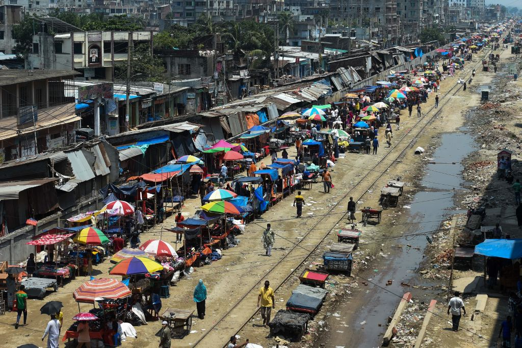 Stalls are seen at a market along a pedestrian area during a government-imposed lockdown as a preventative measure against the spread of the COVID-19 coronavirus in Dhaka. (Photo by MUNIR UZ ZAMAN/AFP via Getty Images)