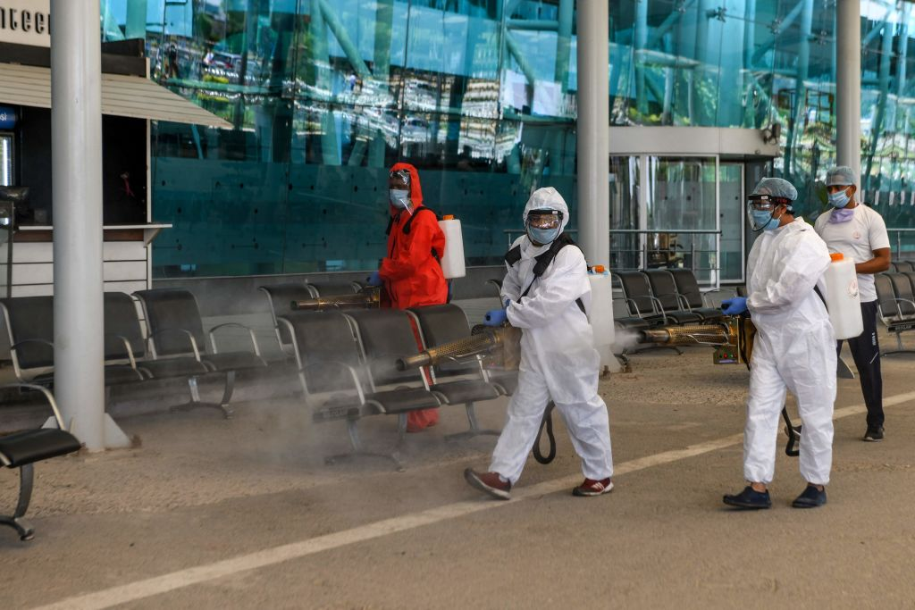 Volunteers spray disinfectant at Sri Guru Ram Dass Jee International Airport after the government eased a nationwide lockdown imposed as a preventive measure against the COVID-19 coronavirus, on the outskirts of Amritsar on May 15, 2020. (Photo by NARINDER NANU/AFP via Getty Images)