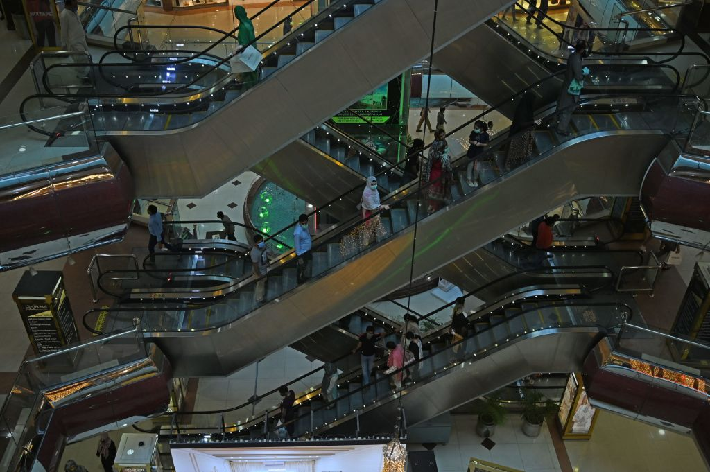 Shoppers are seen inside a shopping mall after the government eased a nationwide lockdown imposed as a preventive measure against the COVID-19 coronavirus, in Islamabad on May 18, 2020. (Photo by AAMIR QURESHI/AFP via Getty Images)