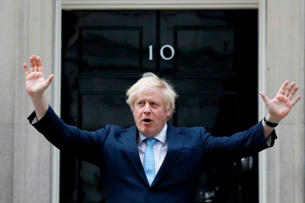 "Prime Minister Boris Johnson during ""clap for carers"" outside 10 Downing Street in London on May 21, 2020.  (Photo: TOLGA AKMEN/AFP via Getty Images)"