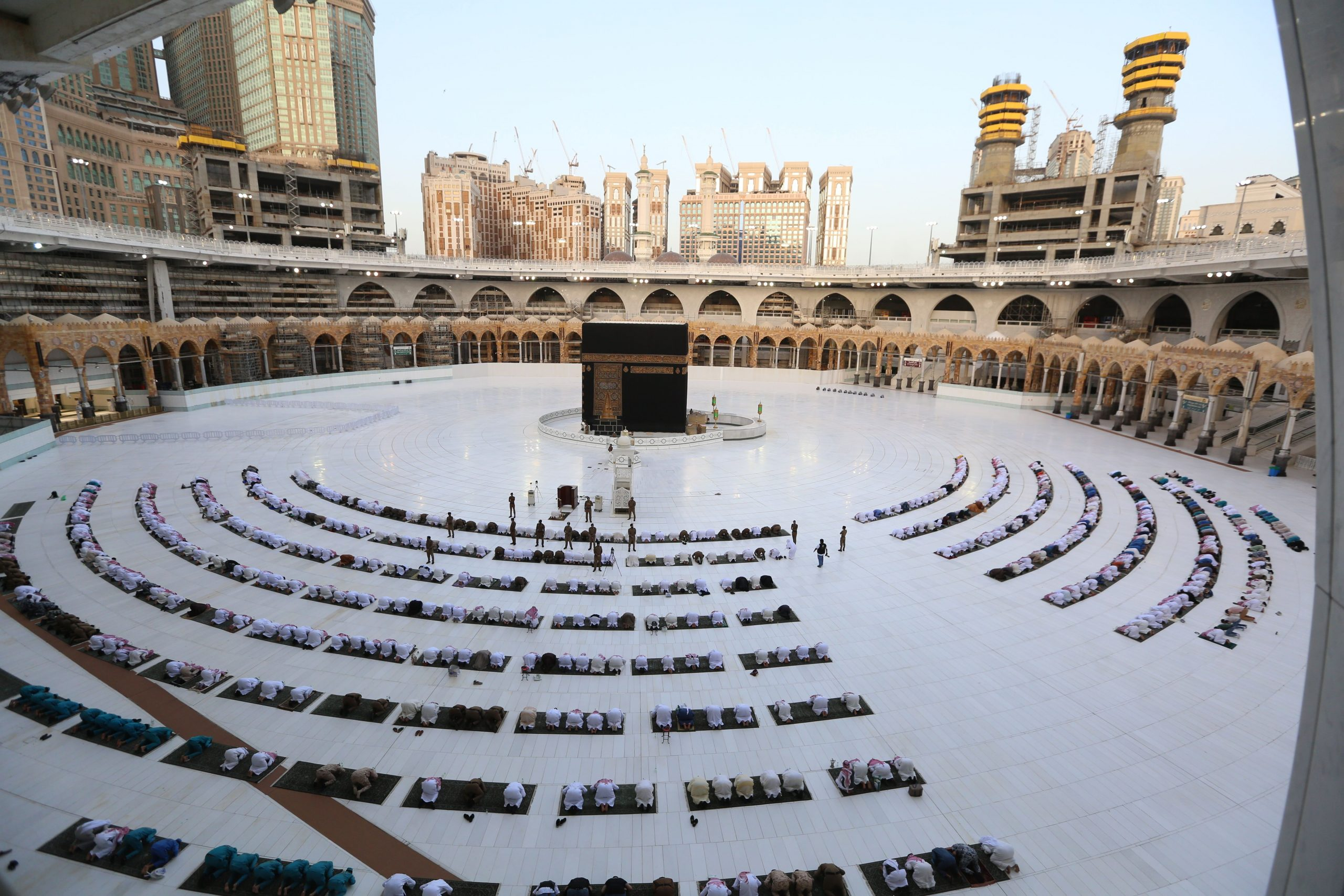 FILE PHOTO: Worshippers gathering before the Kaaba at the Grand Mosque in Saudi Arabia's holy city of Mecca to attend the prayers of Eid al-Fitr early on May 24, 2020. (AFP via Getty Images)