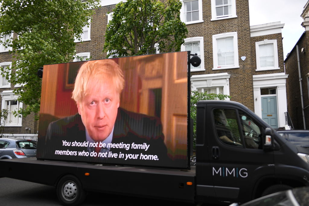 A TV screen is installed in the street outside the home of Dominic Cummings, chief advisor to Prime Minister Boris Johnson, by political campaign group 'Led By Donkeys', on May 24, 2020 in London, England.  (Photo by Peter Summers/Getty Images)
