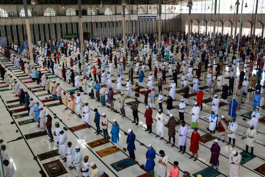 Muslim devotees offer a special prayer at the Baitul Mukarram National Mosque to start the Eid-al-Fitr festival marking the end of the Islamic holy fasting month of  Ramadan in Dhaka on May 25, 2020. (Photo by REHMAN ASAD/AFP via Getty Images)