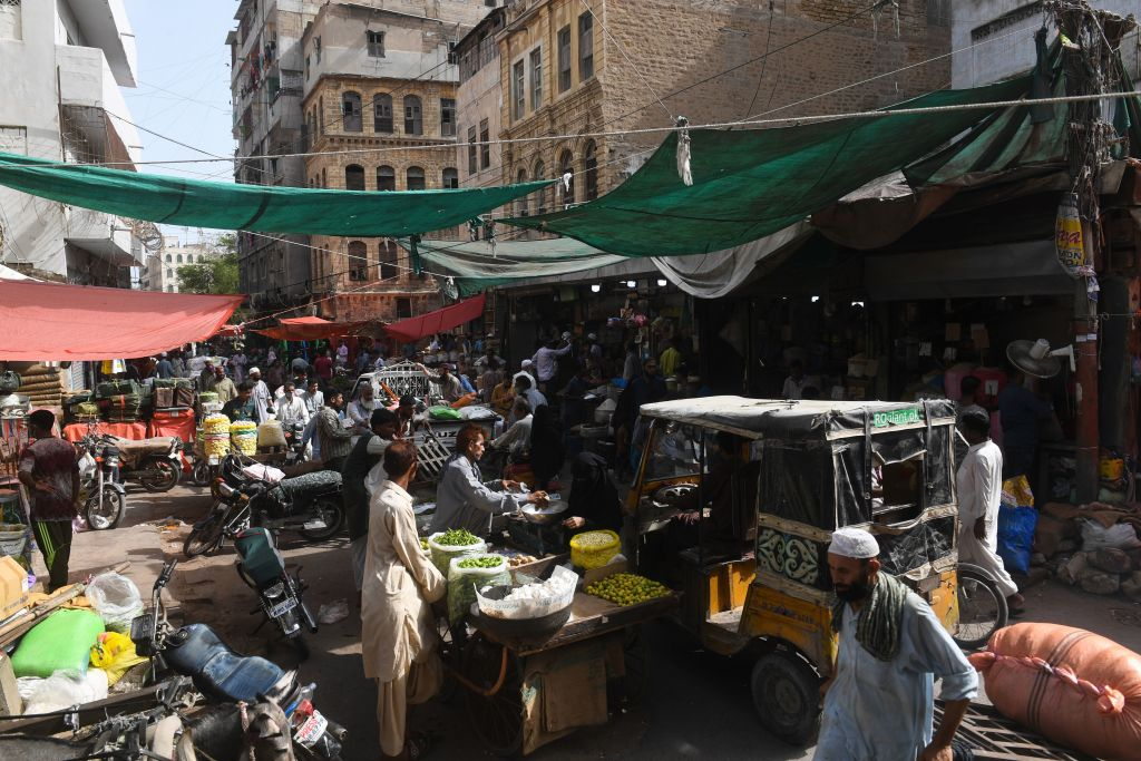 People shop at a market after the government eased a nationwide lockdown imposed as a preventive measure against the COVID-19 coronavirus, in Karachi on May 28, 2020. (Photo by ASIF HASSAN/AFP via Getty Images)