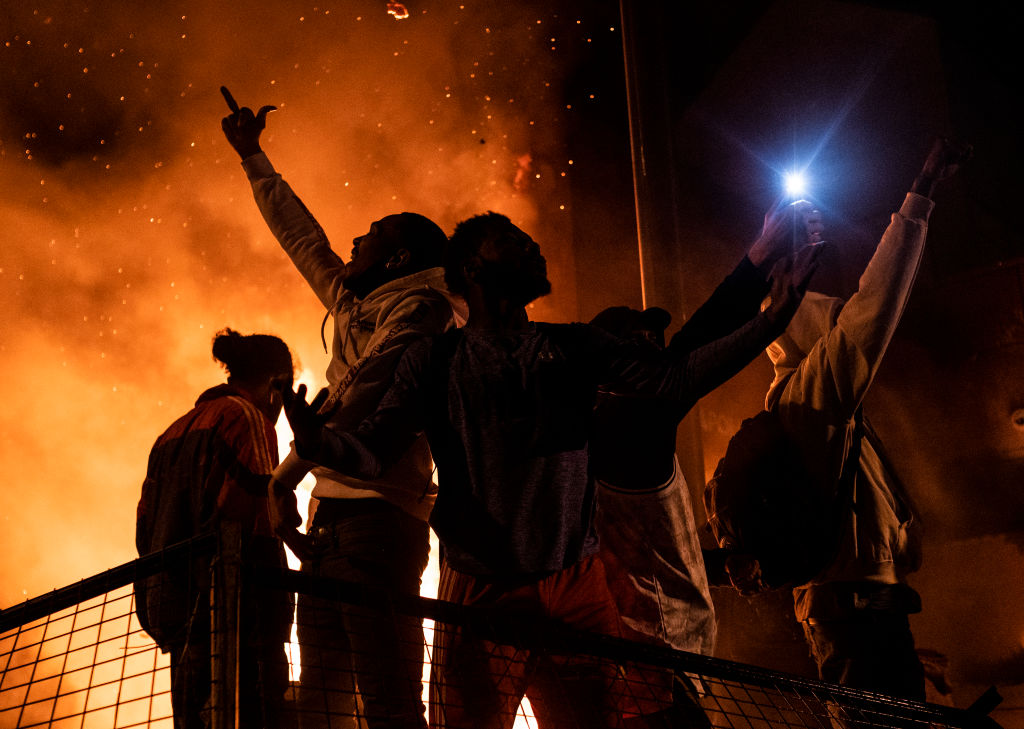 Protesters cheer as the Third Police Precinct burns behind them on May 28, 2020 in Minneapolis, Minnesota. (Photo: Stephen Maturen/Getty Images)