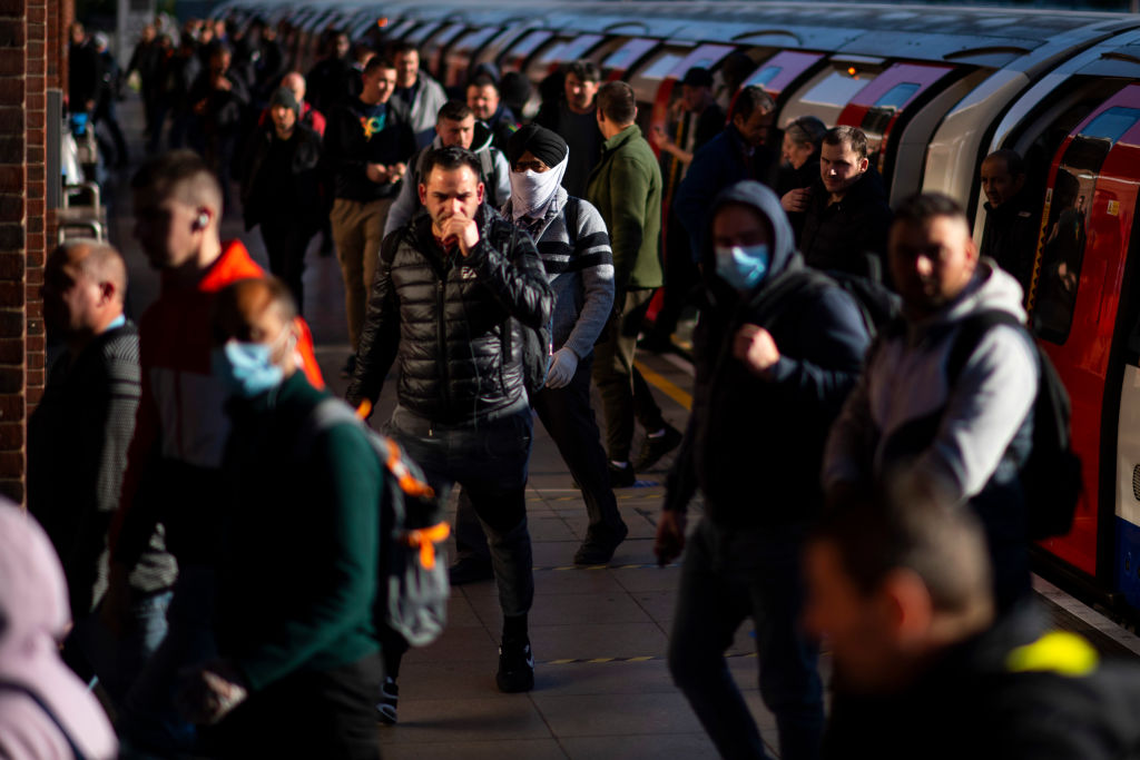 Commuters exit the tube at West Ham station in East London on May 14, 2020. (Photo: Justin Setterfield/Getty Images)