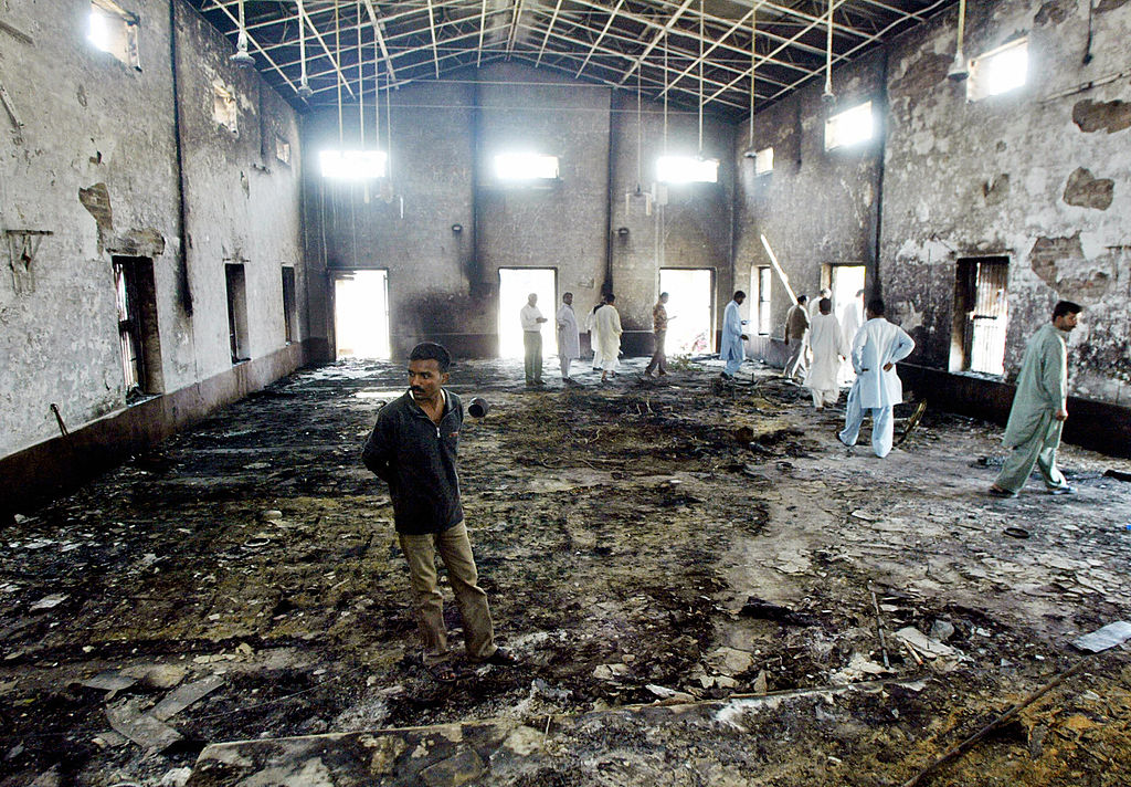 FILE PHOTO: Pakistani Christians gather inside the main service hall of a church after it was torched by angry Muslim protesters in Sangla Hill, west of Lahore (FAROOQ NAEEM/AFP via Getty Images)