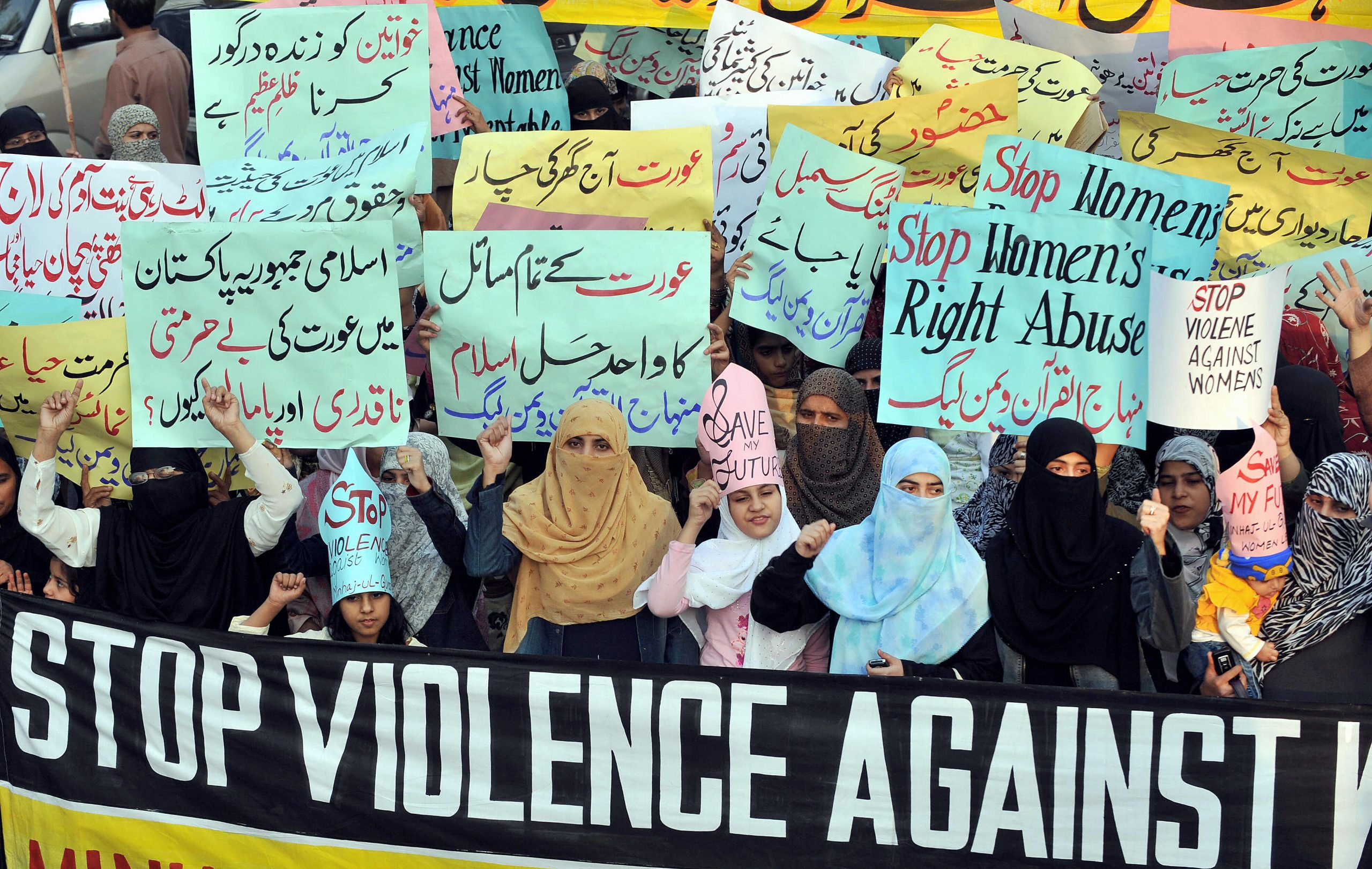 """Supporters of Tehrik-e-Minhaj ul Quran, an Islamic Organisation protest against """"honour killings"""" of women in Lahore on November 21, 2008. Human rights lawyer Zia Awan said that more than 62,000 cases of women abused in Pakistan since the year 2000 and 159 women died in honour killings in the year to September 30. AFP PHOTO/Arif ALI (Photo credit should read Arif Ali/AFP via Getty Images)"""