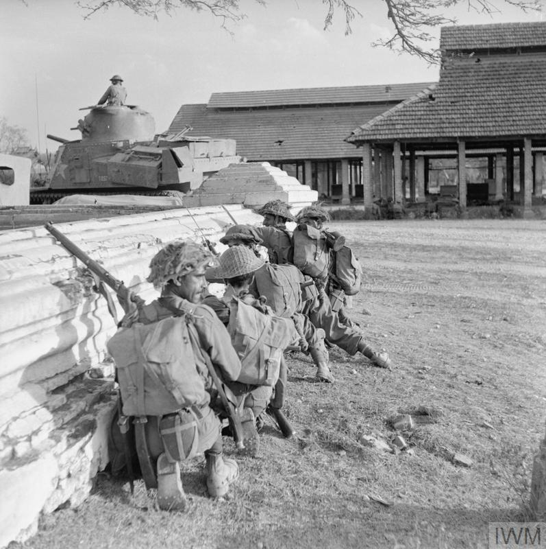 Troops of 19th Indian Division and a Lee tank in action during street fighting in Mandalay 9-10 March 1945