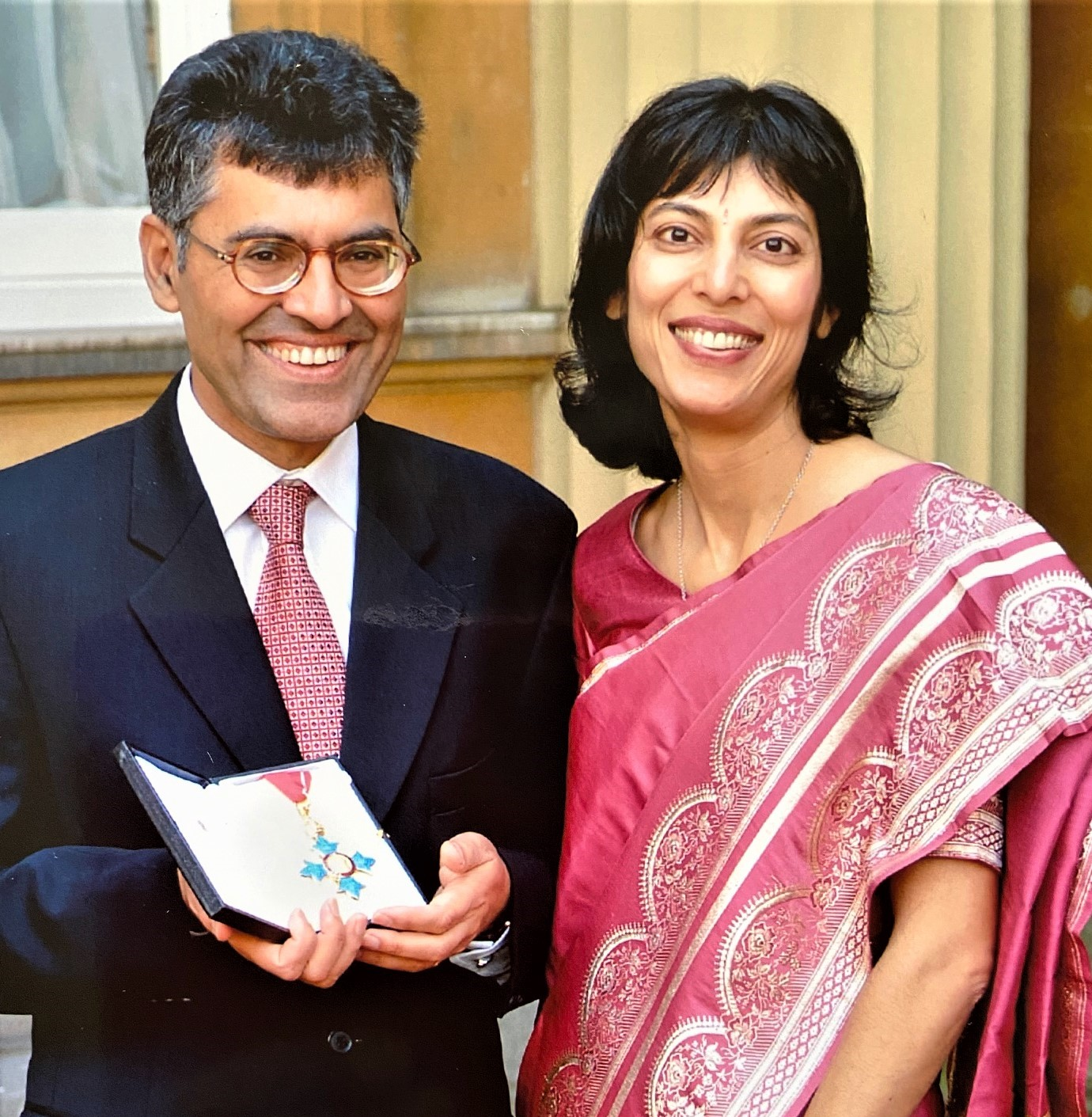 Prof Raj Bhopal and his wife, Roma, at his CBE investiture at Buckingham Palace in 2001.