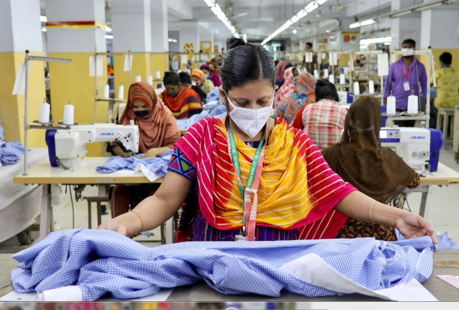 A woman works in a garment factory, as factories reopened after the government has eased the restrictions amid concerns over coronavirus disease (COVID-19) outbreak in Dhaka, Bangladesh, May 3, 2020. REUTERS/Mohammad Ponir Hossain